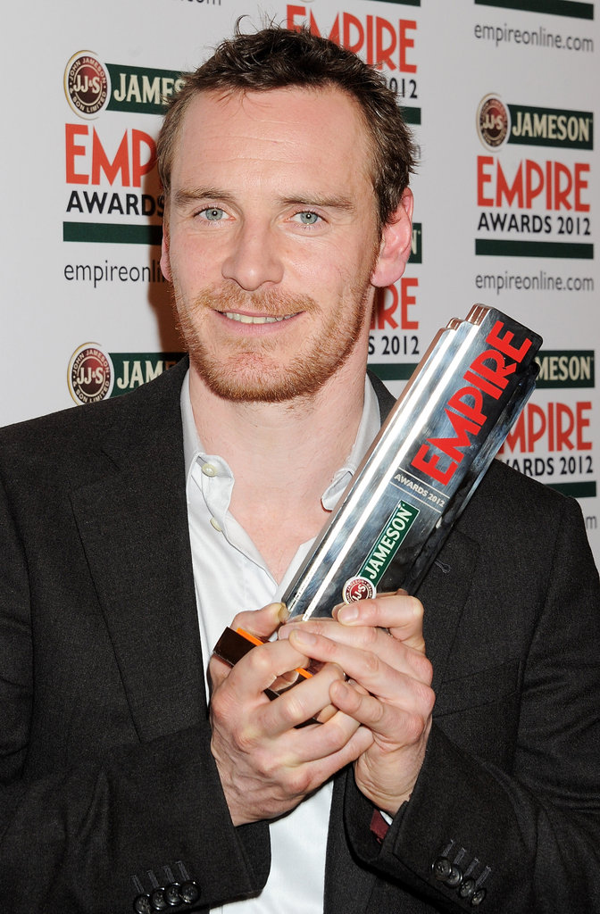 Michael Fassbender holds on tight to his award at the Jameson Empire Awards in London.