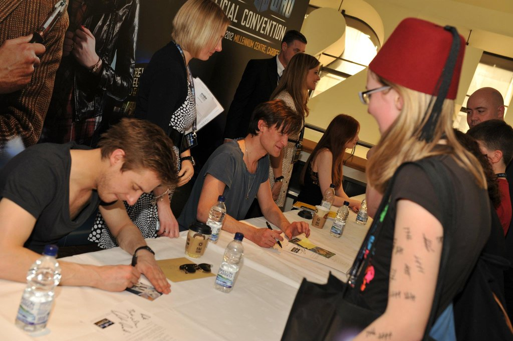 Arthur Darvill and Matt Smith sign autographs for enthusiastically costumed fans. Photo: Doctor Who Facebook, Alexandra Thompson