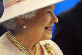 The queen looks happy in Manchester.