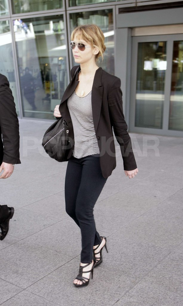 Jennifer Lawrence arrives at London's Heathrow Airport.