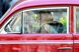Elizabeth Olsen on set driving a car in NYC.