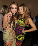 Miley Cyrus and Fergie posed backstage together at the 2011 show.