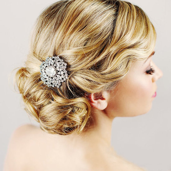 Here's one of the more creative styling ideas we've seen pinned: this cool Elsa Corsi brooch used as a focal point for an elegant bridal chignon.