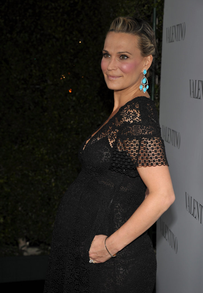Molly Sims wore bright turquoise earrings to Valentino's 50th anniversary party in LA.