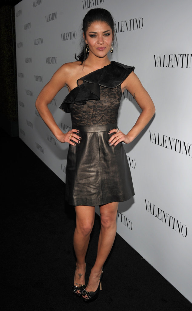 Jessica Szohr smiled on the black carpet of Valentino's 50th anniversary celebrations in LA.