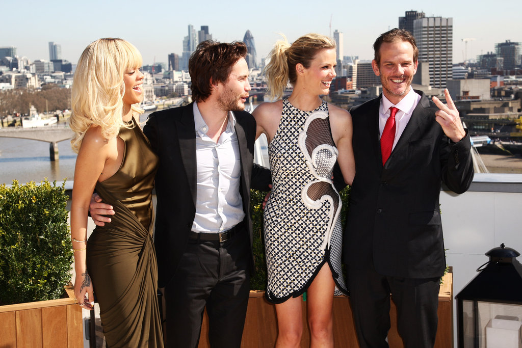 Peter Berg gave a peace sign with Rihanna, Taylor Kitsch, and Brooklyn Decker looking on at a photocall for Battleship in London.
