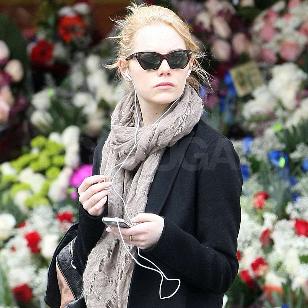 Emma Stone sported black, cat eye shades in NYC.