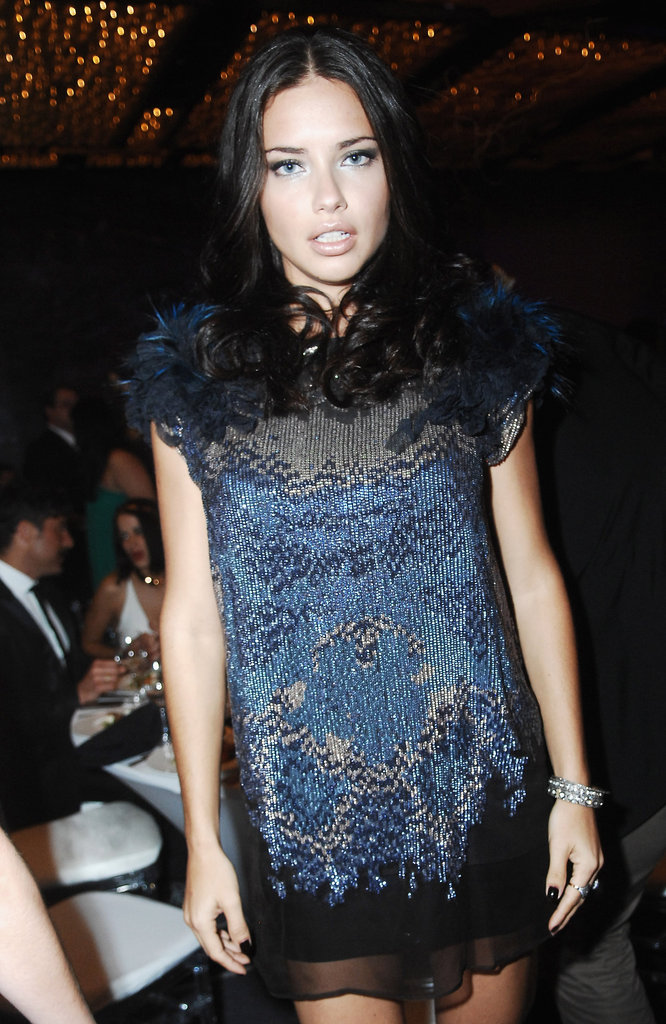 Pregnant Adriana Lima at an event.
