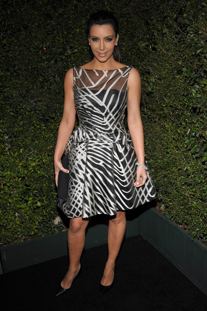 Kim Kardashian wore a sheer printed dress to Valentino's 50th anniversary party in LA.