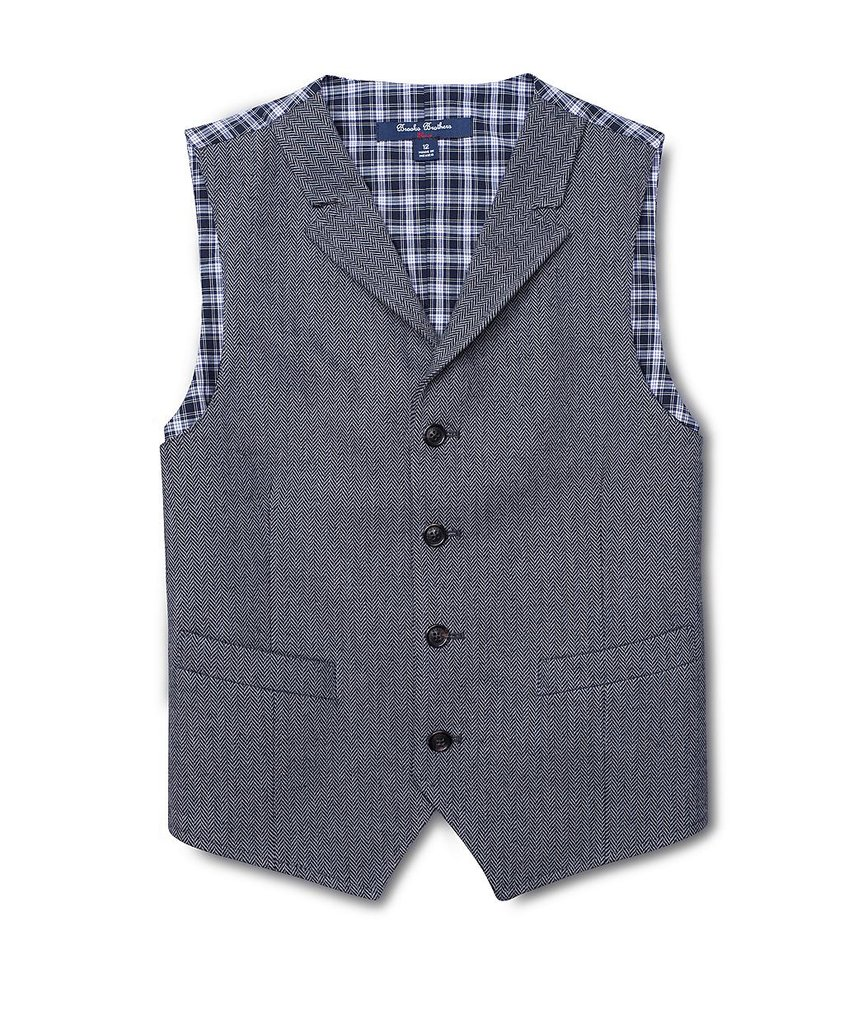 A trick we often rely on? Shopping Brooks Brothers' Boys section — the larger sizes offer a form-fitted silhouette.  Brooks Brothers Herringbone Prep Vest ($44)