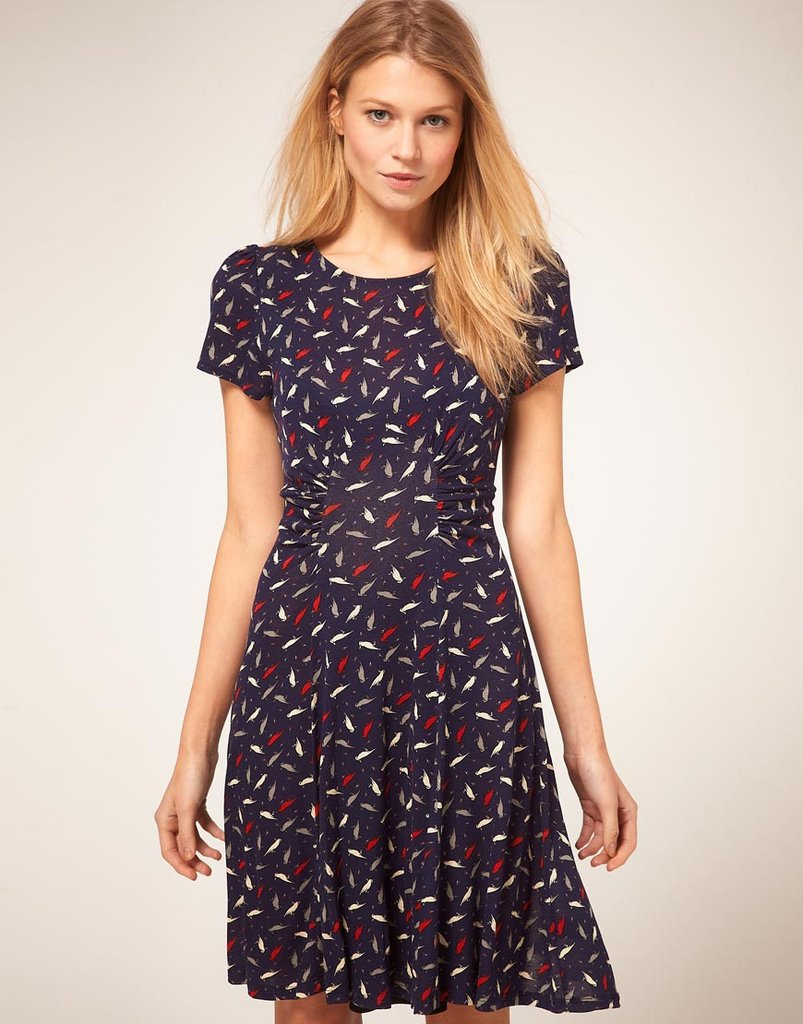 A classic shape gets a cheeky update with a fun print. Just add a tweedy jacket and heels for a day on the job.  Oasis Parrot Print Tea Dress ($75)
