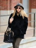 Elizabeth Olsen carried a large black bag.