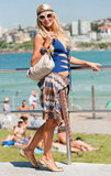 Paris Hilton enjoyed the sun at Bondi Beach in a blue bathing suit.
