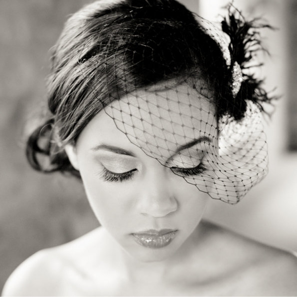Photographer Kaysha Weiner captured this stunning image of bride Tiffany wearing a Tessa Kim fascinator with hair and makeup done by Evelyn from Serene Bridal Beauty.