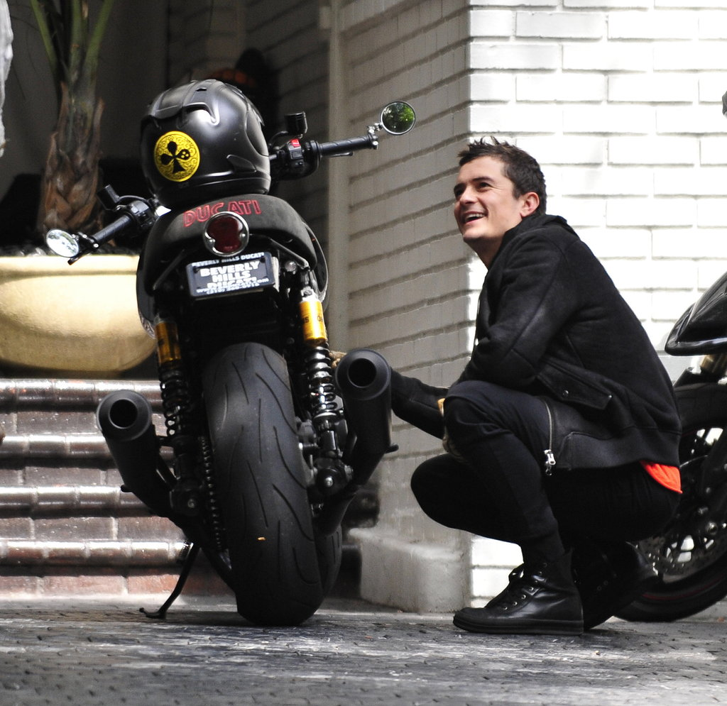 Orlando Bloom worked on his motorcycle.