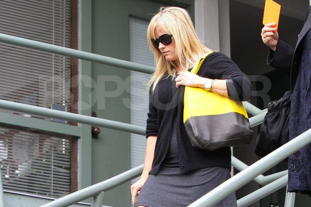Reese Witherspoon stepped out in LA with a black and yellow oversize bag.
