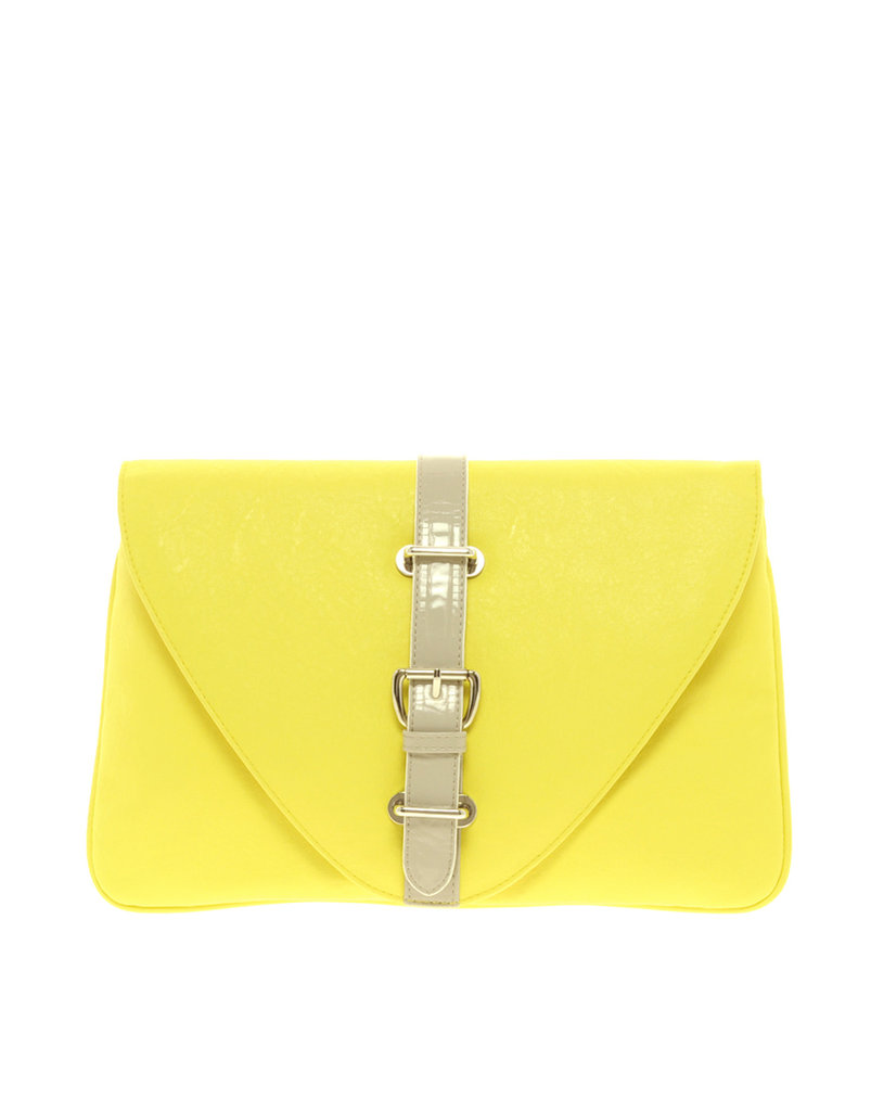 Bright, pretty, and a perfect pop of color against white jeans.  ASOS Contrast Buckle Clutch ($32)