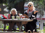 Gwen Stefani at a table with son Zuma during their Whole Foods picnic in an LA park.