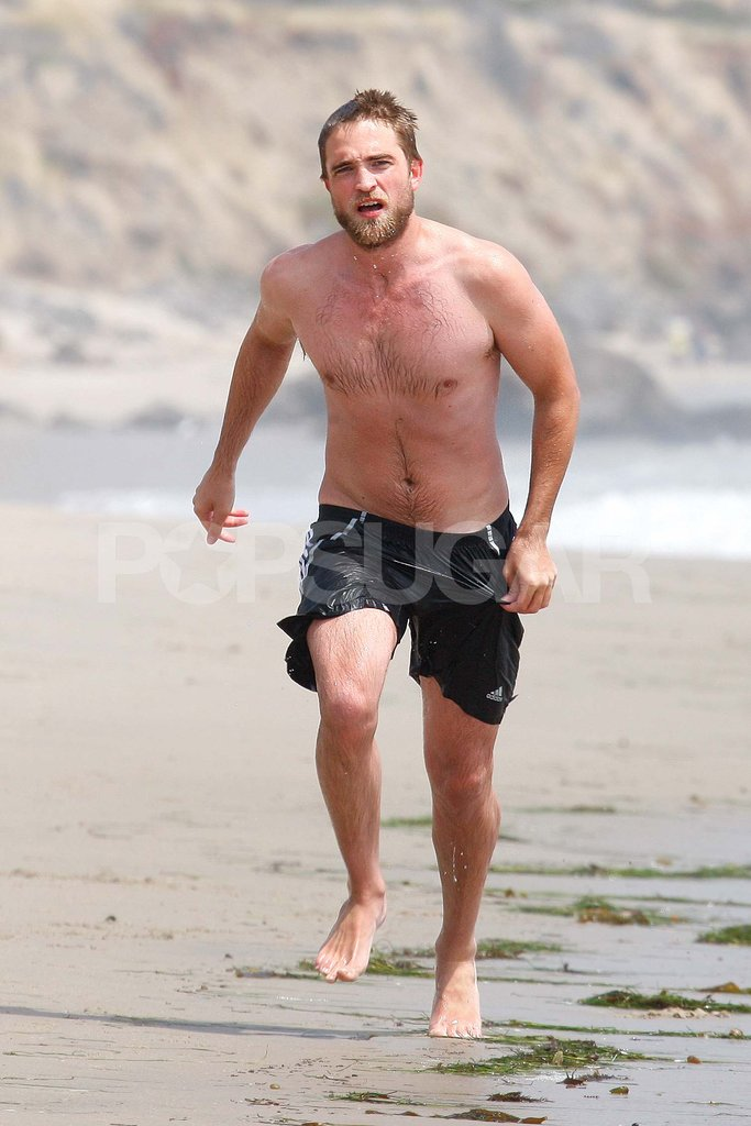 Robert Pattinson went running shirtless on the beach.