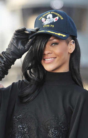 Rihanna wore a hat over her new black hair at a Battleship photocall in Japan.