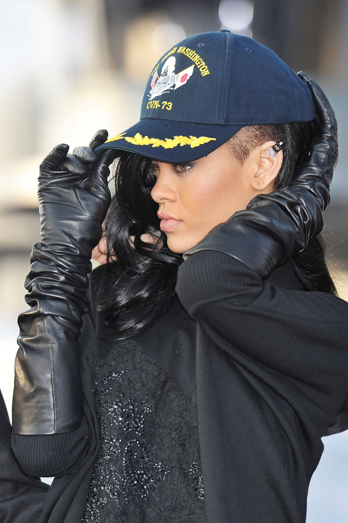 Rihanna struck a pose with a black hat covering her new black hair at a Battleship photocall in Japan.