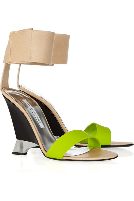 """I'm completely obsessed with these DVF heels. I love the architectural wedge and lime green rubber strap — perfect for dressing up a pair of white skinny jeans and a sweatshirt."" — Brittney Stephens, assistant editor  Diane von Furstenberg Elan Leather Wedge Sandals ($395)"