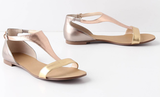 For a Spring-to-Summer evening edge, add metallics for flair. Anthropologie Tingo T-Straps in Gold ($78)