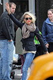Cameron Diaz wore bright red lips and a brown scarf as she hailed a cab in NYC.