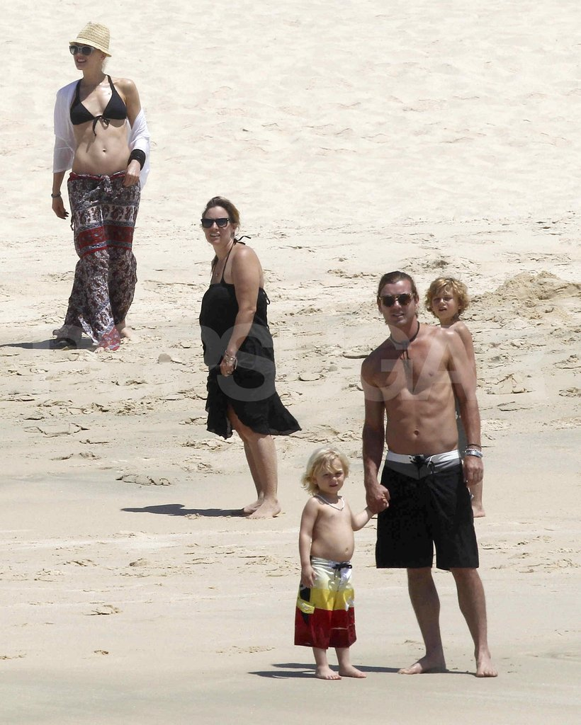 Shirtless Gavin Rossdale, bikini-cladGwen Stefani, Kingston Rossdale, and Zuma Rossdale played at the beach.