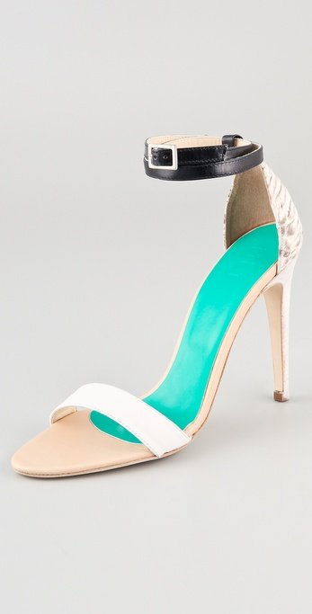 A great neutral with just a little exotic print for added interest. Tibi Amber Snake High Heel Sandals ($365)