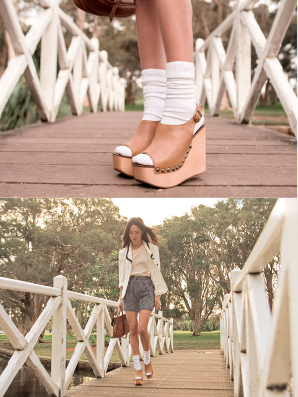 Pair a nautical-inspired white blazer with silky pajama shorts and a quirky sock-sandal combo. Photo courtesy of Lookbook.nu