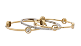 These stackable beauties feel utterly elegant — and they're surprisingly affordable.  Juicy Couture Stackable Bangle Set ($78)