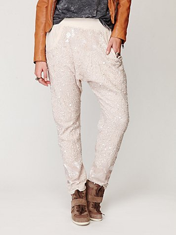 Slouchy sequined harem pants somehow look totally neutral when paired with a t-shirt and sneakers.  Free People Mermaid Sequin Harem Pants ($468)