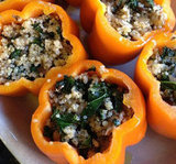 A big plate of quinoa-stuffed peppers are an easy and healthful appetizer to make ahead, before your kitchen gets too crazy.
