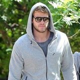 Liam Hemsworth kept a low profile in his dark glasses.