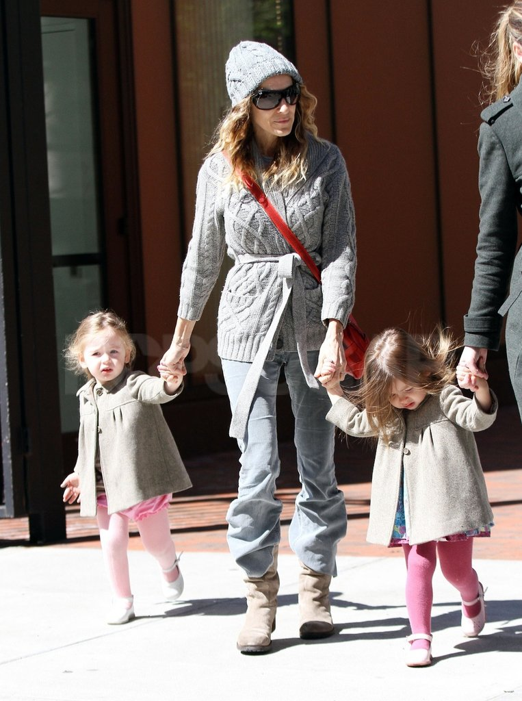 Sarah Jessica Parker wore a hood and sunglasses when she picked her daughters up from school in NYC.