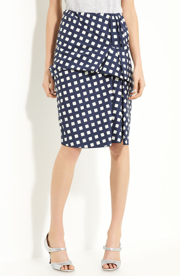 While this skirt may hold its pencil shape, we love that it is totally flirty thanks to a country-cool gingham print and ruffled detail. Marc Jacobs Gingham Drape Front Skirt ($695)
