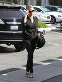 Charlize Theron carried a Givenchy handbag.