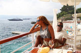 Beyoncé Knowles and Jay-Z lounged on the deck of a yacht.