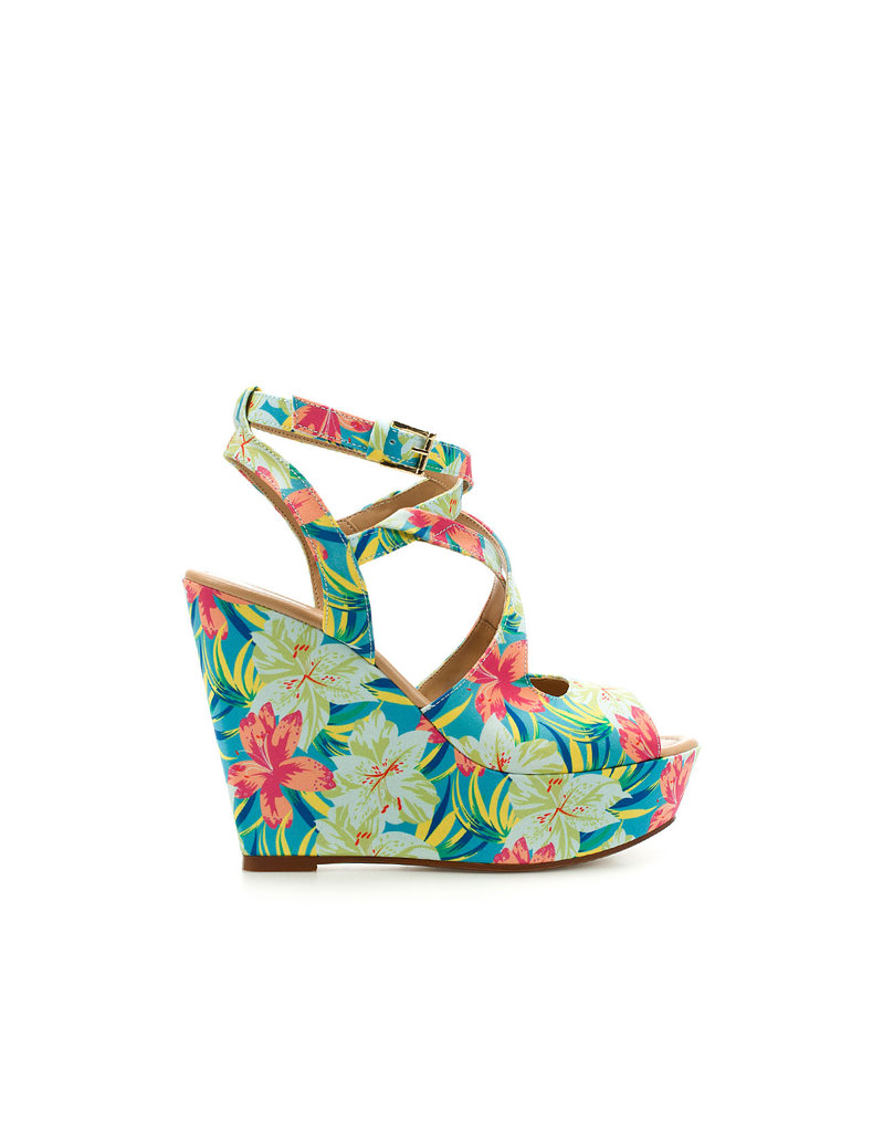 In case you haven't heard, tropical prints are huge for Spring. Add them to your everyday wear to inject a splash of the on-trend.  Zara Floral Wedges ($80)