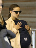 Natalie Portman held tight to baby Aleph while making her way through the airport in Paris.