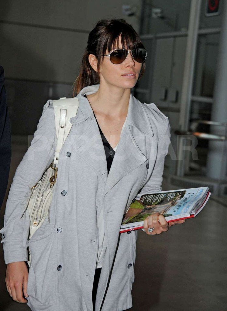 Jessica Biel's engagement ring sparkled while she carried magazines upon arriving at Charles de Gaulle airport in Paris.