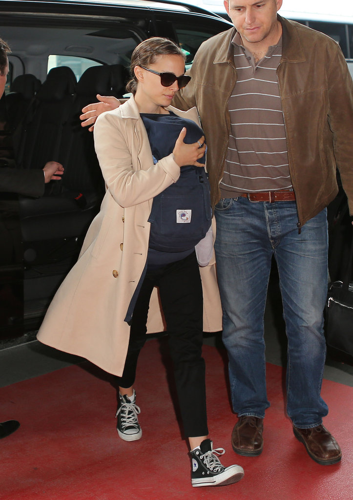 Natalie Portman arrived at the airport in Paris wearing Converse sneakers and carrying baby Aleph.