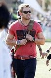 Kellan Lutz checked out the second day of the festival before partying at Neon Carnival later that night.
