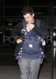 Orlando Bloom carried son Flynn Bloom at LAX.