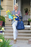 Gwen Stefani had her hands full as she showed up to her parent's house to celebrate Easter.