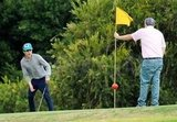 Zac Efron lined up his putt.