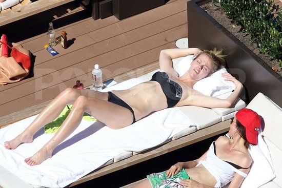 Brooklyn Decker relaxed by the pool at her hotel in Australia.