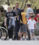 David Beckham held Harper while the boys and Gordon Ramsay's family hung out on Easter.