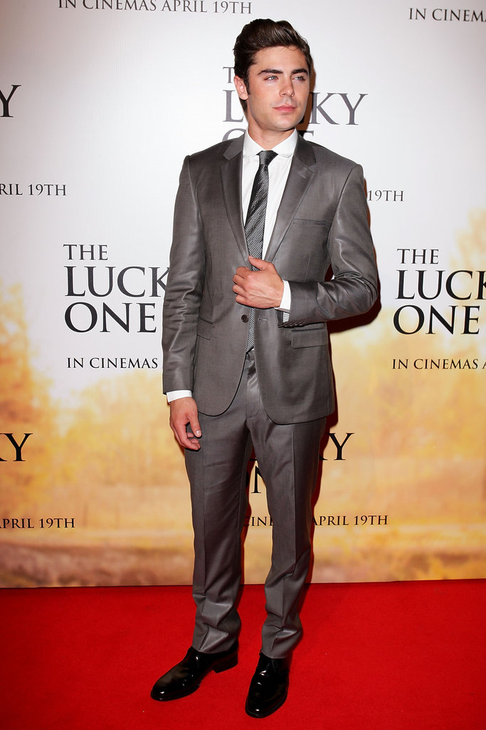 Zac Efron perfected his suit and tie before snapping a few photos.